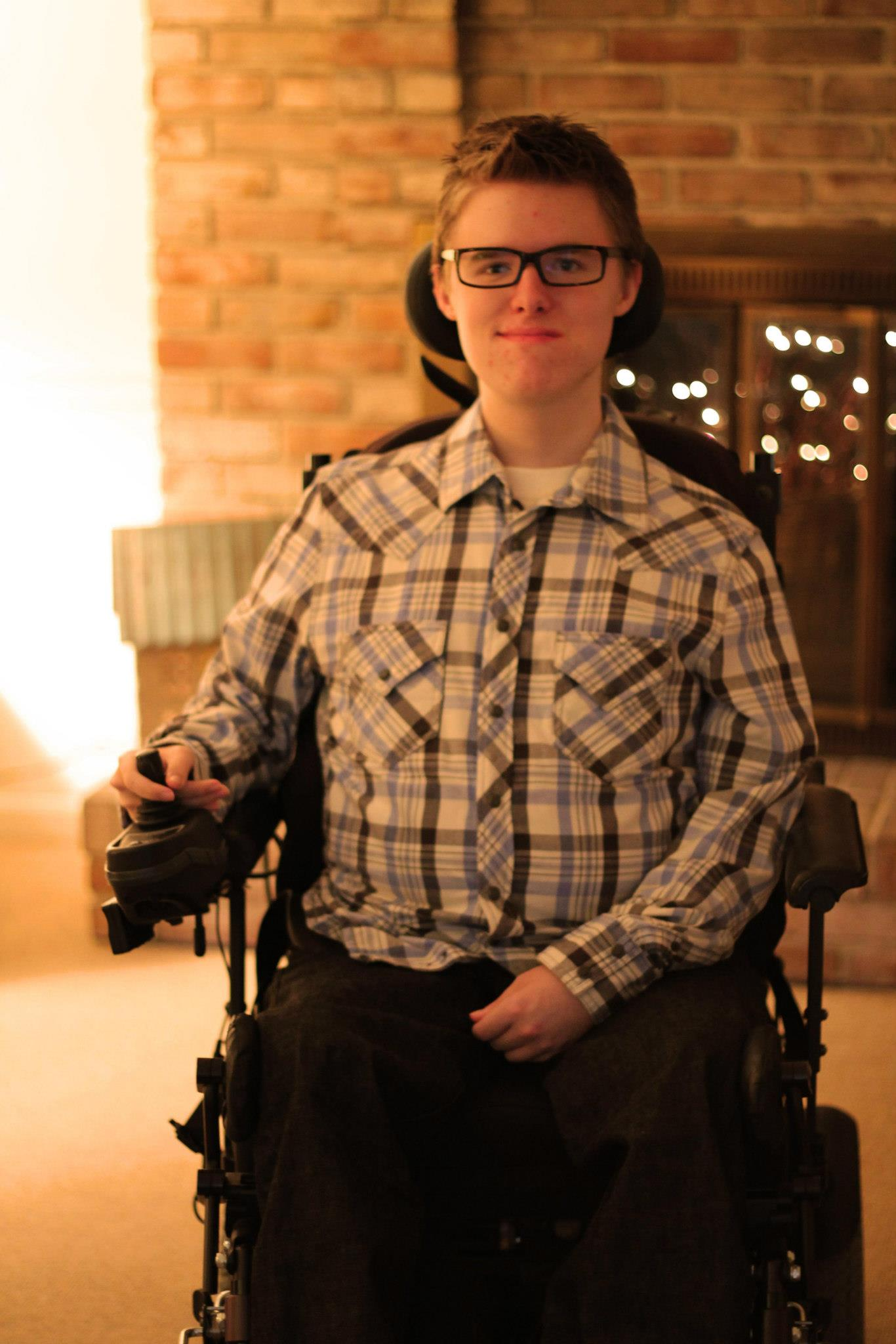 Aaron Adams in a wheelchair Muscular Dystrophy.